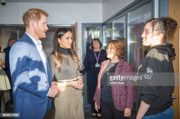 Prince Harry and his fiancee US actress Meghan Markle meet Chantelle Stefanovic during their visit to Nottingham Academy on December 1 2017 in...