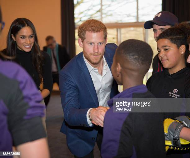 Prince Harry and his fiancee US actress Meghan Markle meet pupils at a Kick Boxing presentation during their visit to Nottingham Academy on December...