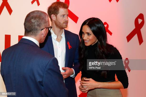 Prince Harry and his fiancee US actress Meghan Markle meet with a representative of a charity working around HIV/AIDS at the Terrence Higgins Trust...