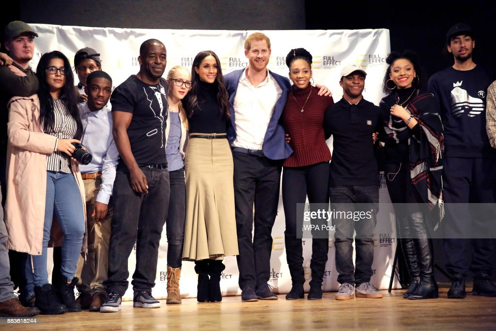 Prince Harry and his fiancee US actress Meghan Markle pose for a photograph with the cast and crew of a hip hop opera performed by young people involved in the Full Effect programme at the Nottingham Academy school on December 1, 2017 in Nottingham, England. Prince Harry and Meghan Markle announced their engagement on Monday 27th November 2017 and will marry at St George's Chapel, Windsor in May 2018.