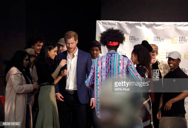 Prince Harry and his fiancee US actress Meghan Markle talk to the cast after a hip hop opera performed by young people involved in the Full Effect...