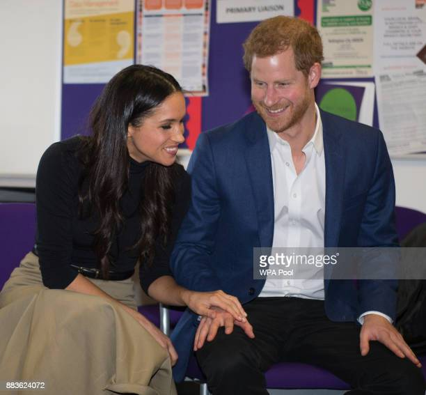 Prince Harry and his fiancee US actress Meghan Markle visit Nottingham Academy on December 1 2017 in Nottingham England Prince Harry and Meghan...