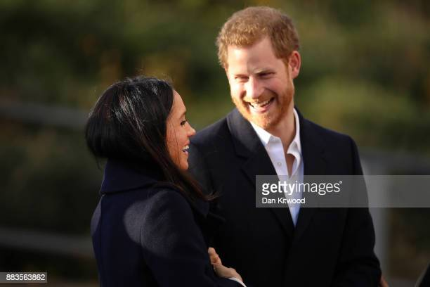 Prince Harry and his fiancee US actress Meghan Markle visit the Nottingham Academy as part of their first official public engagements togetheron...