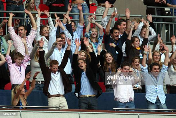 Prince Harry and HRH Prince William enjoy the Mexican Wave during The Concert For Diana held at Wembley Stadium on July 1 2007 in London The concert...
