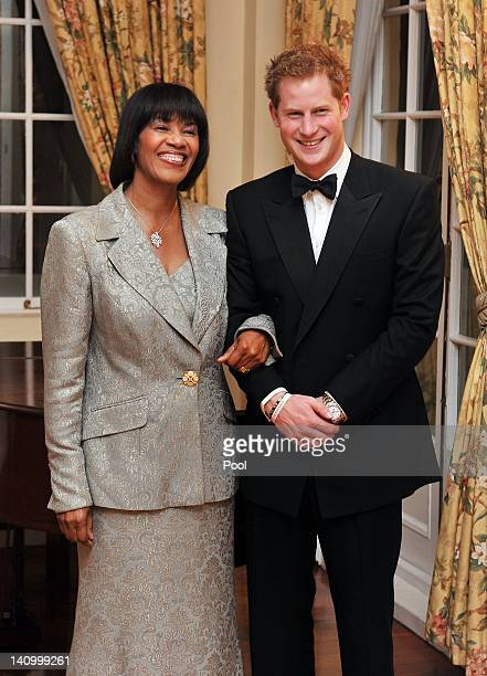 Prince Harry and Jamaican Prime Minister Portia SimpsonMiller pose together at a reception before a state dinner in the King's House on March 6 2012...