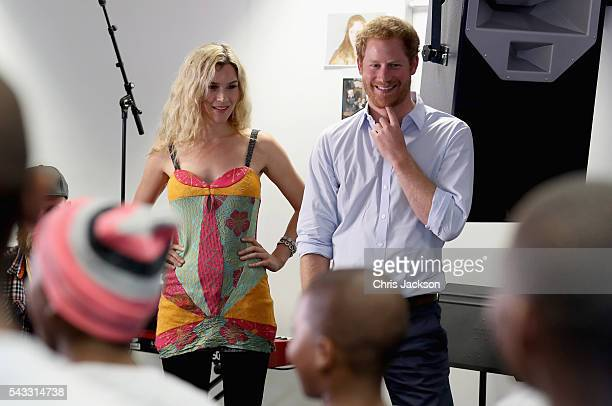 Prince Harry and Joss Stone watch the Basotho Youth Choir made up of six boys and six girls aged between 7 and 19 years old rehearse at the Brit...