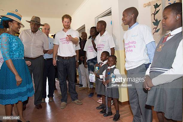 Prince Harry and King Letsie III of Lesotho meet children as they tour the opening of Sentebale's Mamohato Children's Centre during an official visit...