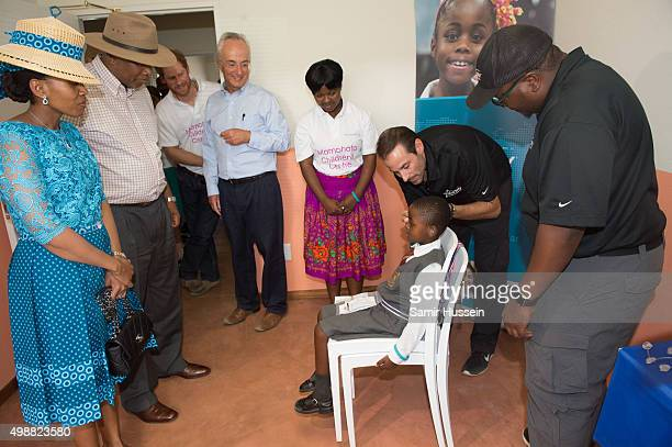 Prince Harry and King Letsie III of Lesotho meet children being fitted with hearing aid as they tour the opening of Sentebale's Mamohato Children's...
