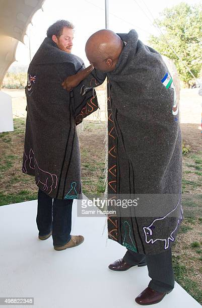 Prince Harry and King Letsie III of Lesotho wear shawls given to them as a gift as they attend the opening of Sentebale's Mamohato Children's Centre...