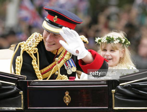 Prince Harry and Lady Louise Windsor travel down The Mall on route to Buckingham Palace in a horse drawn carriage following Prince William, Duke of...