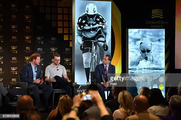 Prince Harry and LCpl John-James Chalmers are seen during the Opening Ceremony of the Invictus Games Orlando 2016 at ESPN Wide World of Sports on May...
