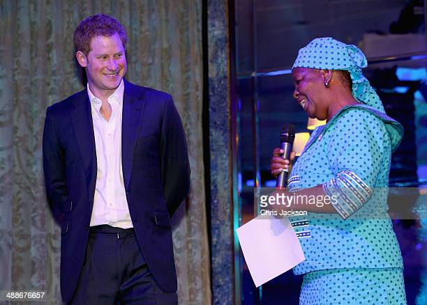 Prince Harry and Malineo Motsephe who received the Service award on stage during the Sentebale Summer Party at the Dorchester Hotel on May 7 2014 in...