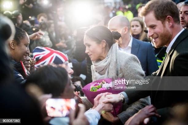 Prince Harry and Meghan Markel meet wellwishers as they visit Reprezent 1073FM on January 9 2018 in London England The Reprezent training programme...