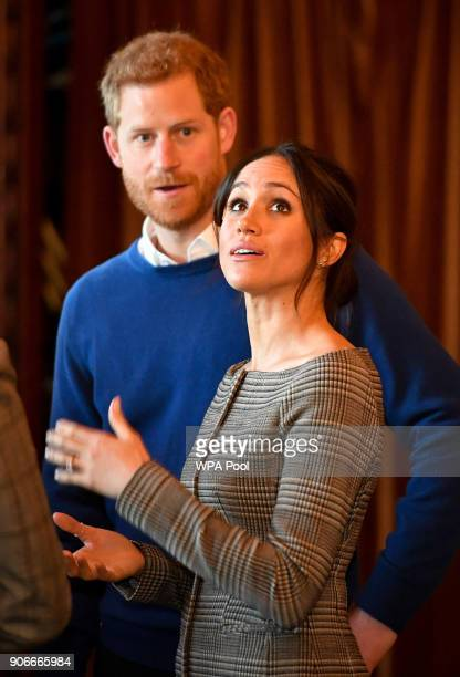 Prince Harry and Meghan Markle admire the interior of the banqueting hall during a visit to Cardiff Castle on January 18 2018 in Cardiff Wales