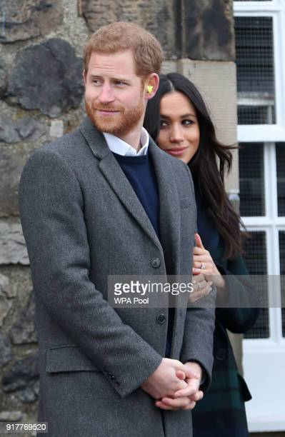 Prince Harry and Meghan Markle after watching the firing of the One o'clock gun during their visit to Edinburgh Castle on February 13 2018 in...