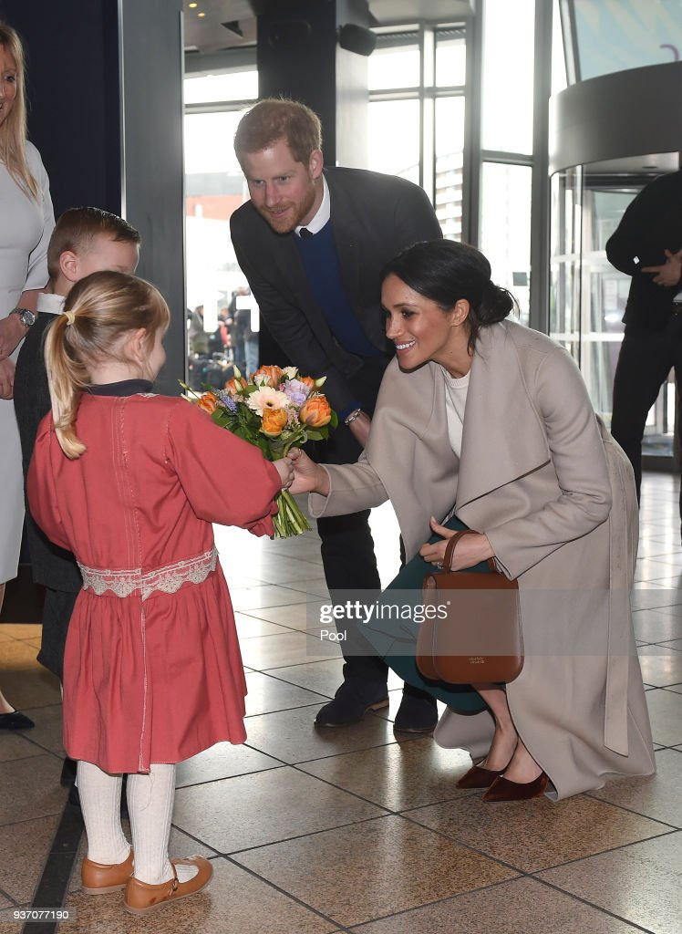 Prince Harry and Meghan Markle are presented with a model of the Titanic by Lleyton Jackson, 6, and Rosie Jackson,4, during a visit to Titanic Belfast maritime museum on March 23, 2018 in Belfast, Nothern Ireland.