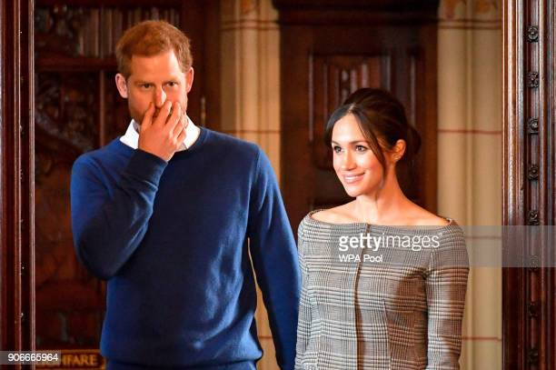 Prince Harry and Meghan Markle arrive in the banqueting hall during a visit to Cardiff Castle on January 18 2018 in Cardiff Wales