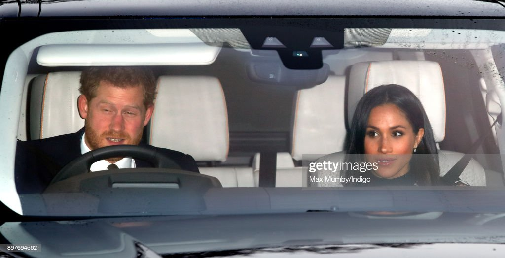 Prince Harry and Meghan Markle attend a Christmas lunch for members of the Royal Family hosted by Queen Elizabeth II at Buckingham Palace on December 20, 2017 in London, England.