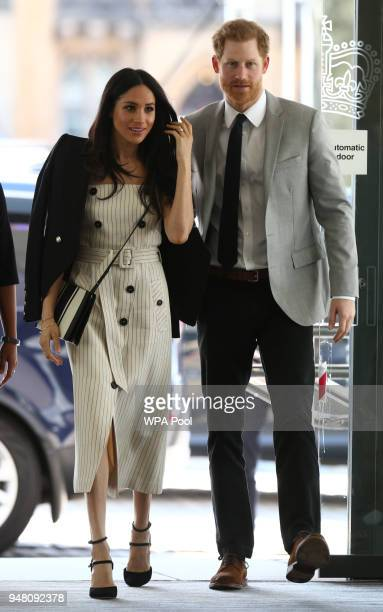 Prince Harry and Meghan Markle attend a reception with delegates from the Commonwealth Youth Forum at the Queen Elizabeth II Conference Centre during...