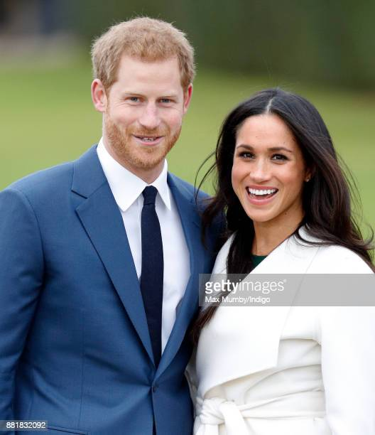 Prince Harry and Meghan Markle attend an official photocall to announce their engagement at The Sunken Gardens Kensington Palace on November 27 2017...