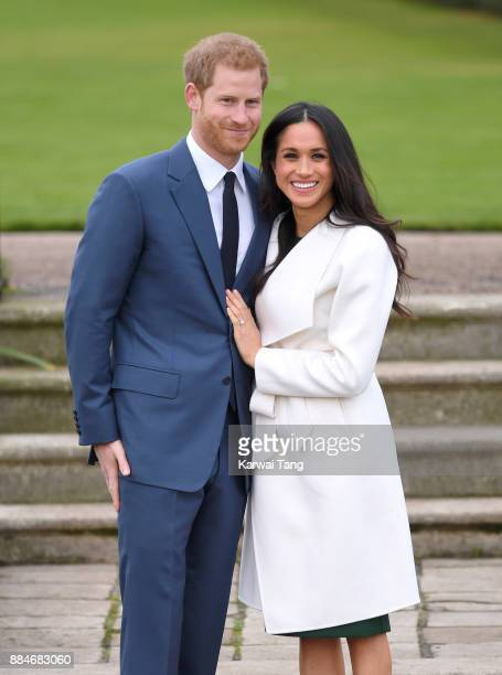 Prince Harry and Meghan Markle attend an official photocall to announce their engagement at The Sunken Gardens at Kensington Palace on November 27...