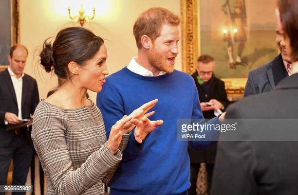 Prince Harry and Meghan Markle chat with people inside the Drawing Room during a visit to Cardiff Castle on January 18 2018 in Cardiff Wales