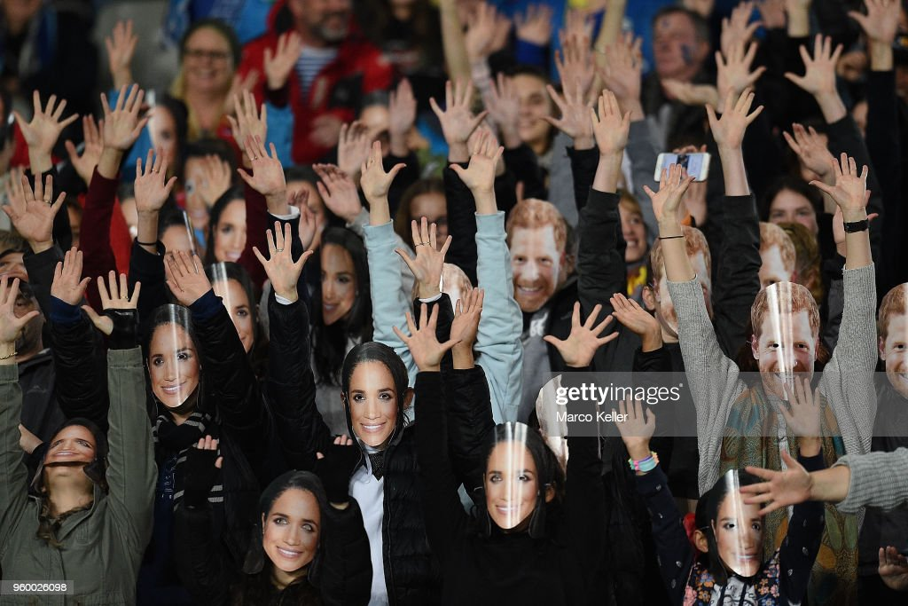 Prince Harry and Meghan Markle covered fans conduct a Flash Mob in honor of the Royal Wedding during the round 14 Super Rugby match between the Blues and the Crusaders at Eden Park on May 19, 2018 in Auckland, New Zealand.