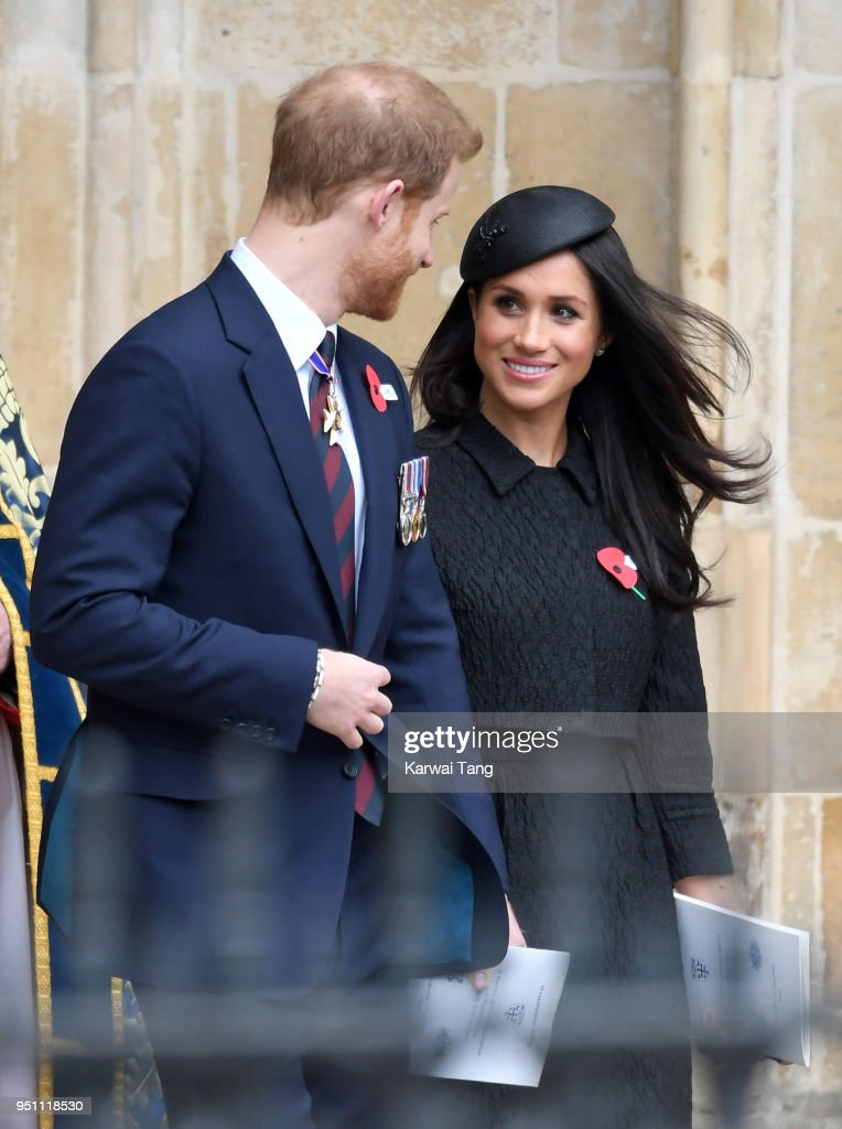 Prince Harry and Meghan Markle depart after attending the Anzac Day service of Thanksgiving and Commemoration at Westminster Abbey on April 25, 2018 in London, England.