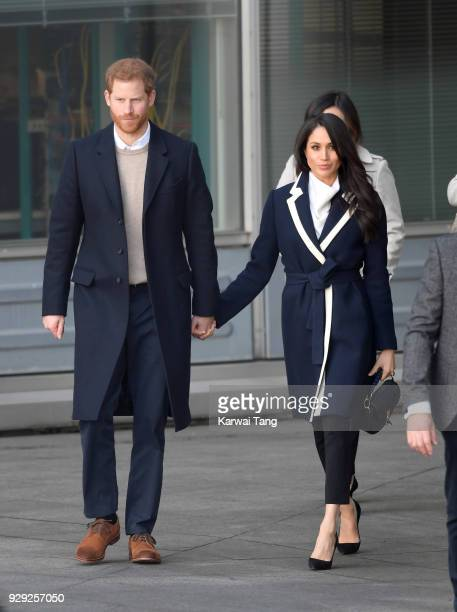 Prince Harry and Meghan Markle depart after visiting Millennium Point on March 8 2018 in Birmingham England