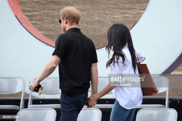 Prince Harry and Meghan Markle depart from a Wheelchair Tennis match during the Invictus Games 2017 at Nathan Philips Square on September 25 2017 in...