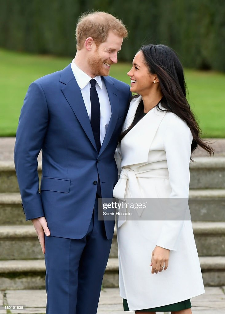 Prince Harry (L) and Meghan Markle during an official photocall to announce the engagement of Prince Harry and actress Meghan Markle at The Sunken Gardens at Kensington Palace on November 27, 2017 in London, England. Prince Harry and Meghan Markle have been a couple officially since November 2016 and are due to marry in Spring 2018.