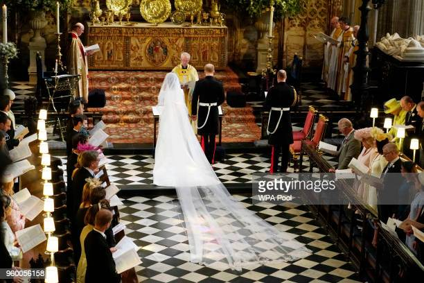Prince Harry and Meghan Markle during their wedding ceremony in St George's Chapel at Windsor Castle on May 19, 2018 in Windsor, England.