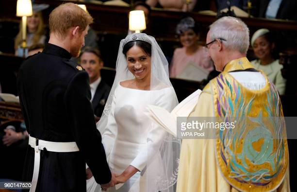 Prince Harry and Meghan Markle during their wedding service, conducted by the Archbishop of Canterbury Justin Welby in St George's Chapel at Windsor...