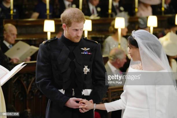 Prince Harry and Meghan Markle during their wedding service in St George's Chapel at Windsor Castle on May 19, 2018 in Windsor, England.