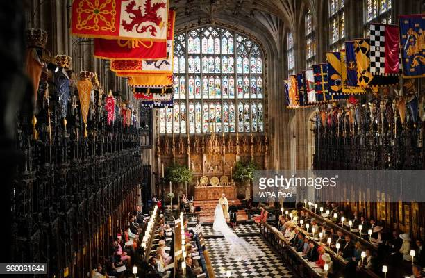 Prince Harry and Meghan Markle exchange vows during their wedding ceremony in St George's Chapel at Windsor Castle on May 19, 2018 in Windsor,...