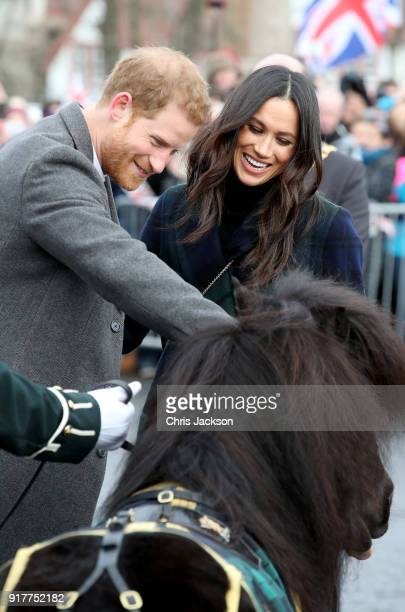 Prince Harry and Meghan Markle greet a pony as they arrive to Edinburgh Castle on February 13 2018 in Edinburgh Scotland