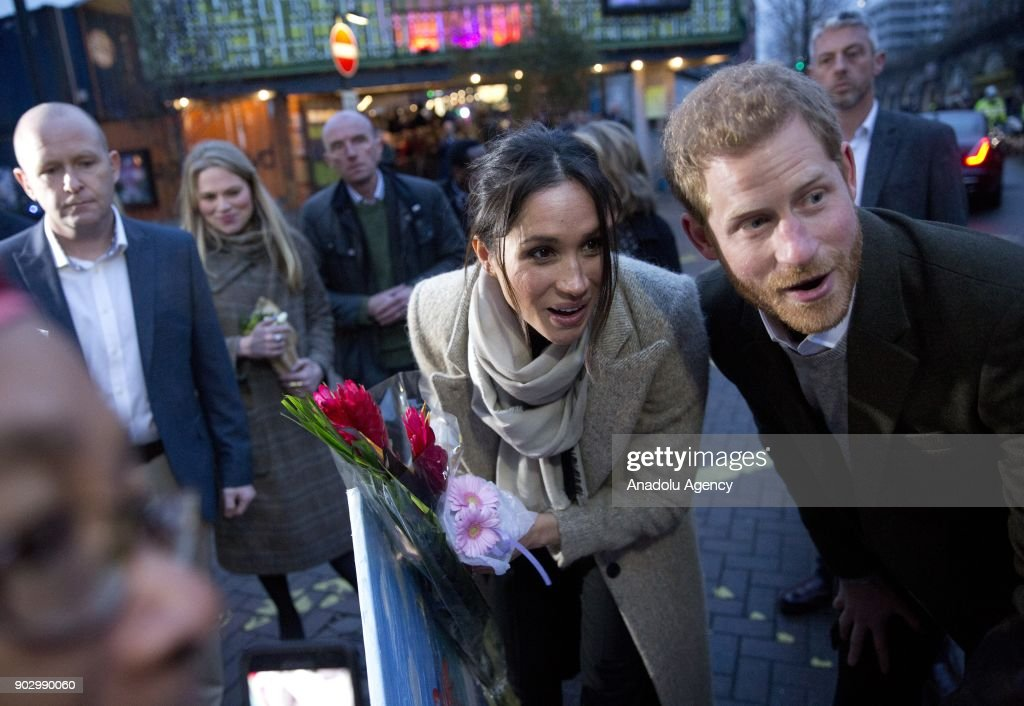 Prince Harry (R) and Meghan Markle (2nd R) greet the crowd as they arrive Pop Brixton to see the broadcaster's work supporting young people through creative training at Reprezent FM's office in Brixton, London, England on January 9, 2018.