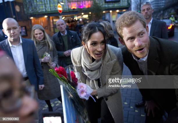 Prince Harry and Meghan Markle greet the crowd as they arrive Pop Brixton to see the broadcaster's work supporting young people through creative...
