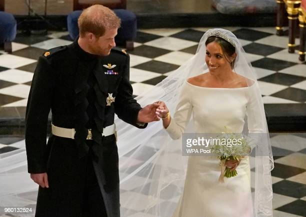 Prince Harry and Meghan Markle in St George's Chapel at Windsor Castle during their wedding service on May 19, 2018 in Windsor, England.