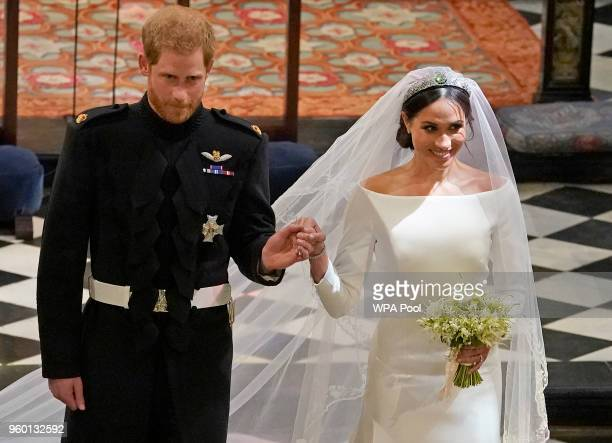 Prince Harry and Meghan Markle in St George's Chapel at Windsor Castle during their wedding service at St Georges Chapel on May 19, 2018 in Windsor,...