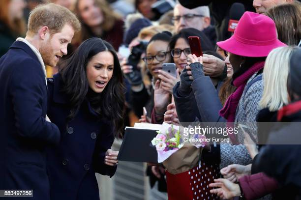 Prince Harry and Meghan Markle interact with crowd as they visit Nottingham Contemporary on December 1 2017 in Nottingham England Prince Harry and...