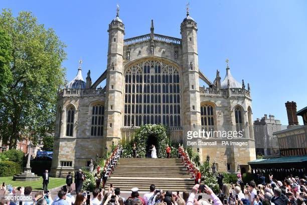 Prince Harry and Meghan Markle kiss as they leave at St George's Chapel in Windsor Castle after their wedding ceremony