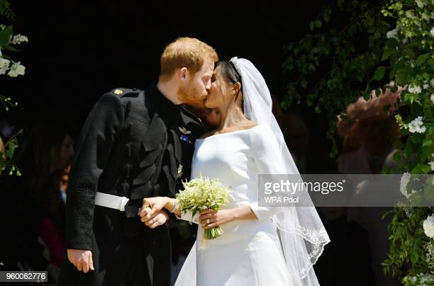 Prince Harry and Meghan Markle kiss on the steps of St George's Chapel in Windsor Castle after their wedding in St George's Chapel at Windsor Castle...