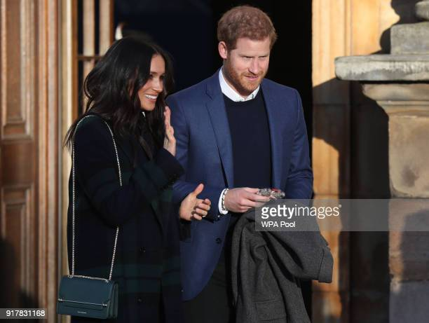Prince Harry and Meghan Markle leave a reception for young people at the Palace of Holyroodhouse on February 13 2018 in Edinburgh Scotland