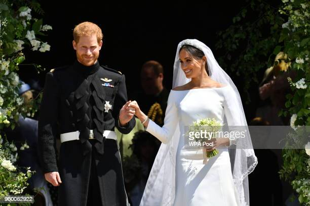 Prince Harry and Meghan Markle leave St George's Chapel after their wedding in St George's Chapel at Windsor Castle on May 19 2018 in Windsor England