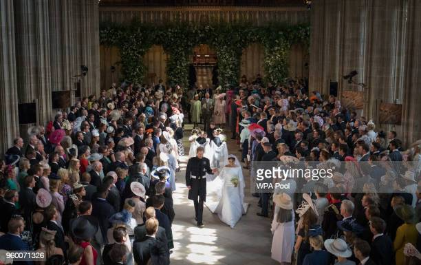 Prince Harry and Meghan Markle leave St George's Chapel at Windsor Castle after their wedding on May 19, 2018 in Windsor, England.