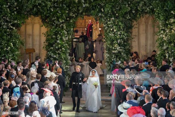 Prince Harry and Meghan Markle leave St George's Chapel at Windsor Castle after their wedding on May 19 2018 in Windsor England