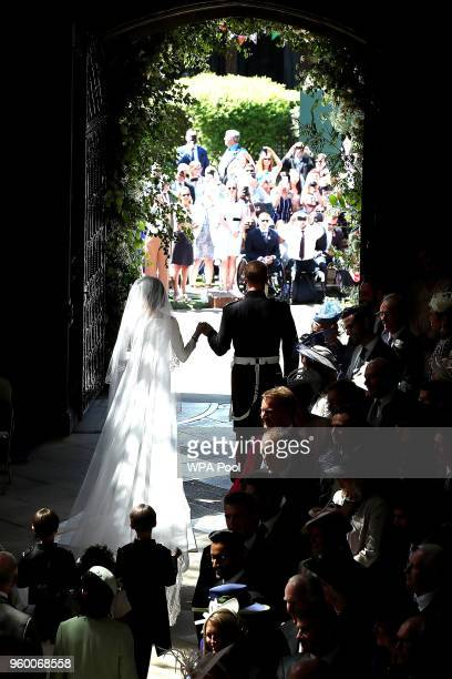 Prince Harry and Meghan Markle leave St George's Chapel in Windsor Castle after their wedding in St George's Chapel at Windsor Castle on May 19 2018...