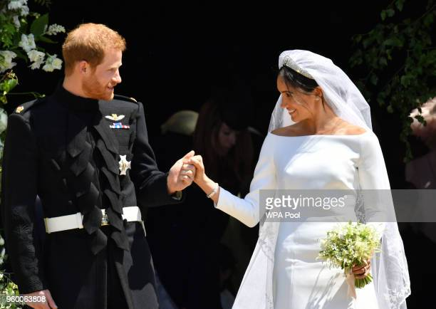 Prince Harry and Meghan Markle leave St George's Chapel through the west door after their wedding in St George's Chapel at Windsor Castle on May 19...