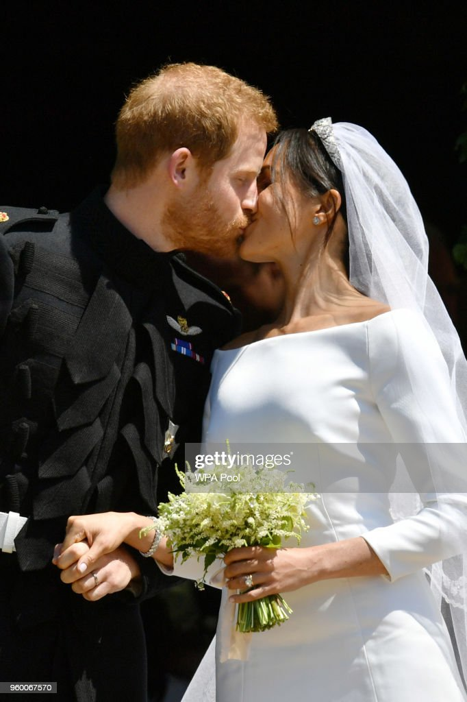 Prince Harry and Meghan Markle leave St George's Chapel through the west door after their wedding in St George's Chapel at Windsor Castle on May 19, 2018 in Windsor, England.